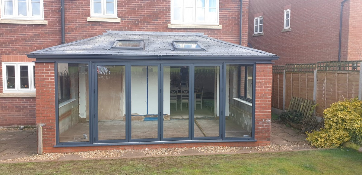 Upgraded Lean to conservatory with Guardian Roof with Velux Vents and Visofold Bi Folding Doors