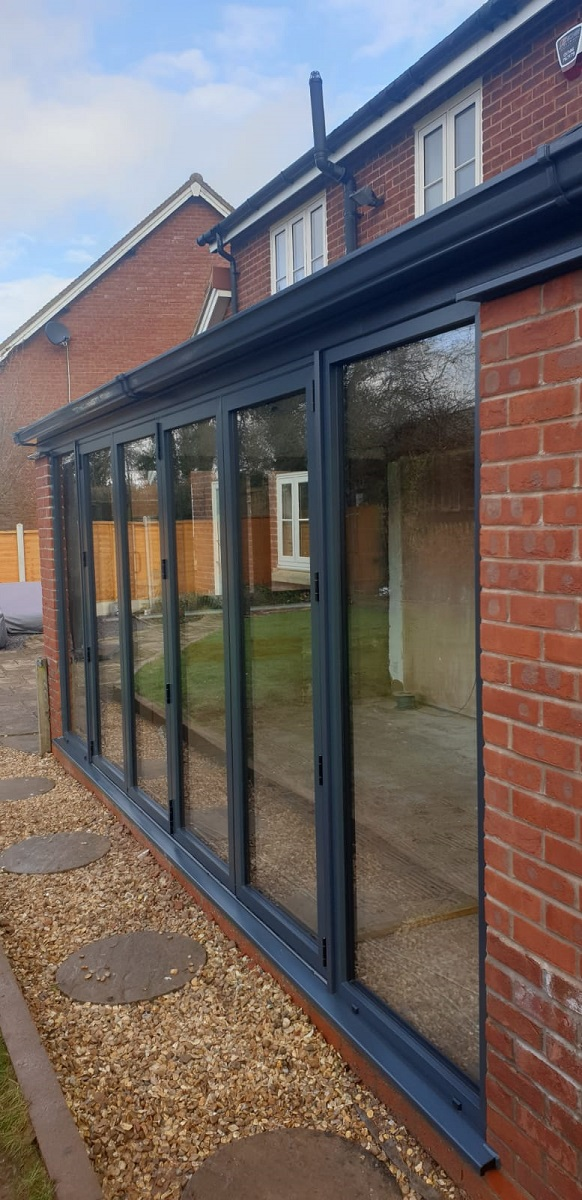 Visofold Bifolding Doors Powder Coated Grey on lean to roof conservatory